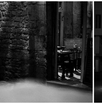 """una fotografia d'""""street photography"""" amb una persona fumant i una altre caminant sol - Autor: Ivan"""